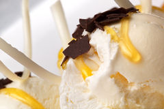 Vanilla ice cream with honey and chocolate Stock Images