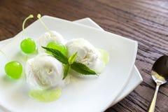 Vanilla ice cream with maraschino cherries Stock Image