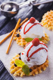 Vanilla Ice Cream with Mint and waffles. Homemade Organic product. On the wooden table. Royalty Free Stock Image