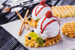 Vanilla Ice Cream with Mint and waffles. Homemade Organic product. On the wooden table. Royalty Free Stock Photo