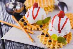 Vanilla Ice Cream with Mint and waffles. Homemade Organic product. On the wooden table. Royalty Free Stock Photography