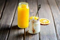 Vanilla ice cream with orange jam. On wooden background Royalty Free Stock Images
