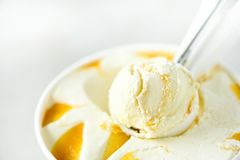 Vanilla ice cream scoop background. Summer food concept, copy space, top view. Scooped texture. Scooping out yellow Stock Image