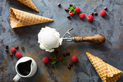 Vanilla ice cream scoop in a spoon. Perfect vanilla ice cream scoop in a spoon with waffles cones and fesh berries Stock Photo