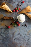 Vanilla ice cream scoop in a spoon. Perfect vanilla ice cream scoop in a spoon with waffles cones and fesh berries with copy space Stock Image