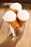 Vanilla ice cream scoops in waffle cones Stock Images