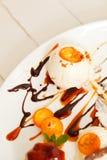 Vanilla ice cream with sliced kumquats Royalty Free Stock Photography