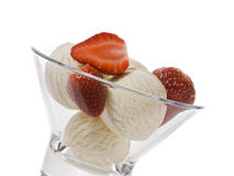 Vanilla ice cream with strawberries in bow Royalty Free Stock Images