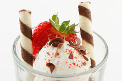 Vanilla ice cream with strawberry and wafers Stock Image