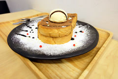 Vanilla Ice Cream Toast Bread with Icing Sugar on Wooden Table Royalty Free Stock Photo