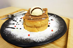 Vanilla Ice Cream Toast Bread with Icing Sugar on Wooden Table Royalty Free Stock Photography