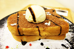 Vanilla Ice Cream Toast Bread with Icing Sugar on Wooden Table Royalty Free Stock Photos