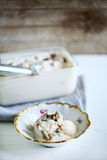 Vanilla ice cream with truffles, homemade in a rustic bowl Stock Photography