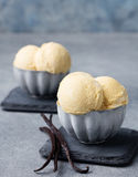 Vanilla Ice Cream with vanilla pods in metal vintage bowl. Homemade Organic product Copy space Stock Photos