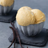 Vanilla Ice Cream with vanilla pods in metal vintage bowl. Royalty Free Stock Image
