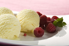 Vanilla icecream with raspberries close-up Stock Photos