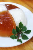 Vanilla jelly. And leafage in a white pan Royalty Free Stock Images