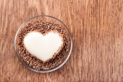 Vanilla jelly in the form of heart. On wooden background royalty free stock image