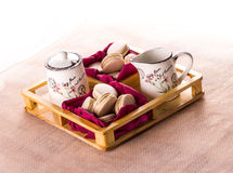 Vanilla macarons in wooden box. Wrapped in paper on white background Stock Images