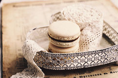 Vanilla macaroon with caramel filling at heart plate Royalty Free Stock Image