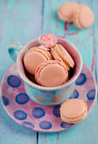 Vanilla macaroon in colorful cup Stock Images