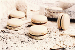 Vanilla macaroon cookies and vintage laces Royalty Free Stock Images