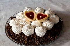 vanilla meringue cookies and two sweet hearts Royalty Free Stock Image