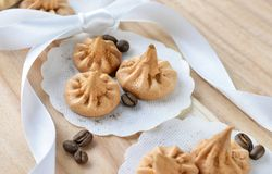 Vanilla meringue cookies on wooden background with copy space. Stock Photos