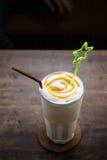 Vanilla milk shake on wooden table Stock Photography