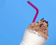 Vanilla Milkshake with Chocolate cream. On a blue background Royalty Free Stock Images