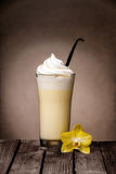 Vanilla milkshake with a pod and flower Stock Photos