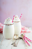 Vanilla milkshake with whipped cream and sprinkles Royalty Free Stock Photos
