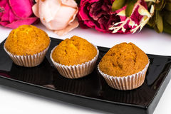 Vanilla mini muffins with chocolate topping Stock Photo