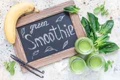 Vanilla, mint, spinach and coconut milk detox green smoothie in a glass, horizontal, top view Stock Image