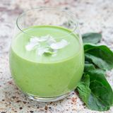 Vanilla, mint, spinach and coconut milk detox green smoothie in a glass, square format Royalty Free Stock Image