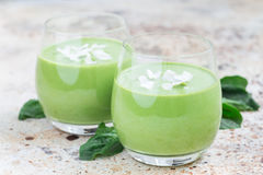 Vanilla, mint, spinach and coconut milk detox green smoothie, horizontal. Vanilla, mint, spinach and coconut milk detox green smoothie in glass, horizontal stock image