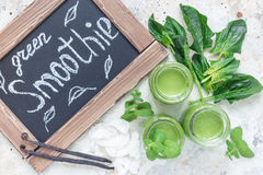 Vanilla, mint, spinach and coconut milk detox green smoothie , horizontal, top view Stock Images