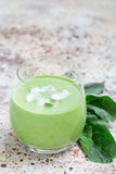 Vanilla, mint, spinach and coconut milk detox green smoothie, vertical, copy space Stock Photo