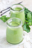 Vanilla, mint, spinach and coconut milk detox green smoothie, vertical Stock Images