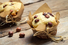 Vanilla muffin with nuts stock photos