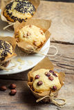 Vanilla muffin with nuts wrapped in paper Stock Images