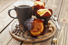 Vanilla muffins. With coffee on the table Stock Photos
