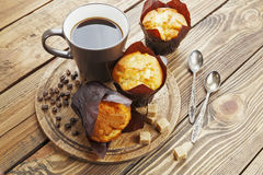 Vanilla muffins. With coffee on the table Royalty Free Stock Photos