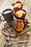 Vanilla muffins. With coffee on the table Stock Photography
