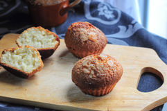 Vanilla muffins on kitchen board Stock Images