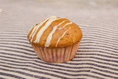 Vanilla muffins on a table cloth background Royalty Free Stock Images