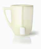 Vanilla mug with white tea label on cord Stock Images