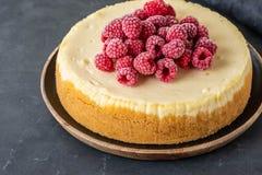Vanilla New York cheesecake with raspberries. Copy spase. stock image