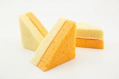 Vanilla and orange chiffon cake isolated on white background Stock Photo