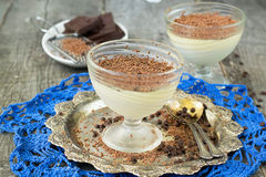 Vanilla panna cotta with chocolate on a wooden background. selec Royalty Free Stock Photography